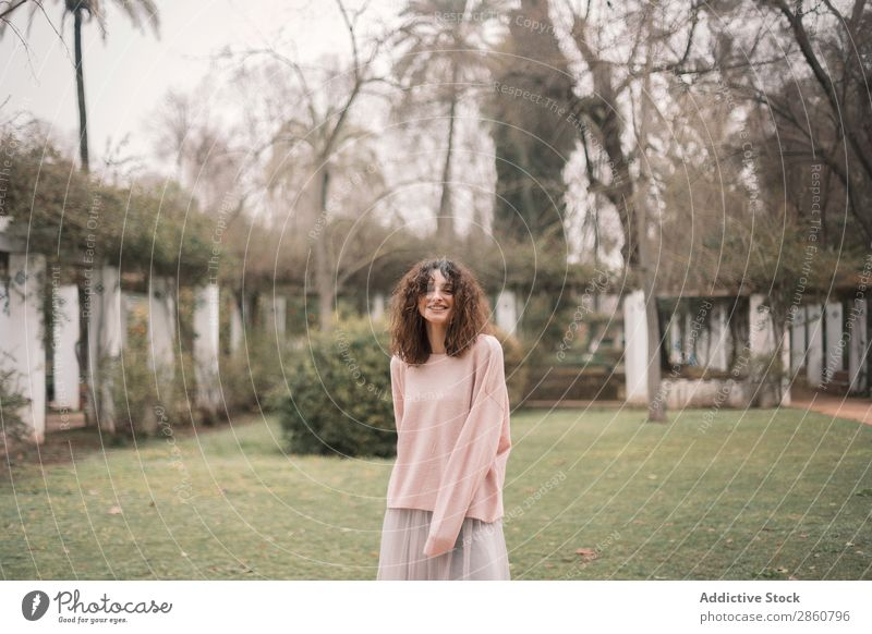 Trendy woman in exotic garden Woman charm Garden Style Fashion Freedom Park Landscape pretty Summer Recklessness Thin Vacation & Travel Brunette Alley