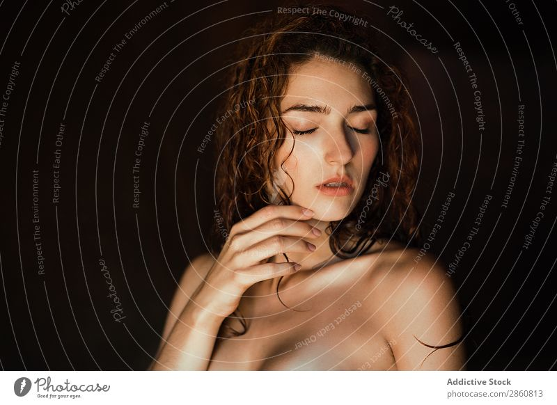 Alluring topless model with eyes closed Woman To enjoy Touch Beautiful Provocative Eroticism Curls Dream Charming Sensitive touching face Considerate wet hair