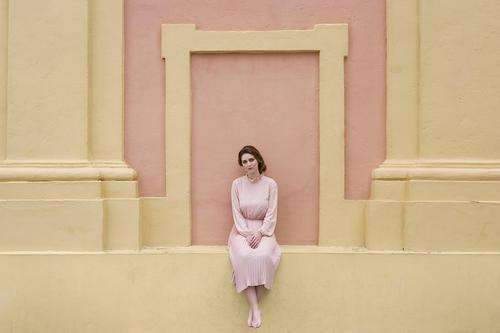 Woman in pink dress posing at wall pretty Youth (Young adults) Dress Vintage Pink Wall (building) Posture Sit Beautiful Attractive Human being