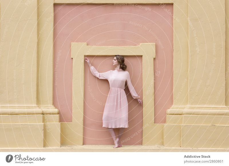 Woman in pink dress posing at wall pretty Youth (Young adults) Dress Vintage Pink Wall (building) Posture Stand Sit Beautiful Attractive Human being