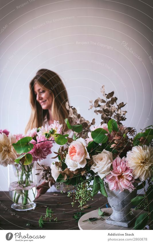 Woman near table with bouquets of blooms in vases Flower Bouquet Vase Table Plant Chrysanthemum Rose Twig Happy Fresh bunch Leaf Wood Lady Branch Bud Nature
