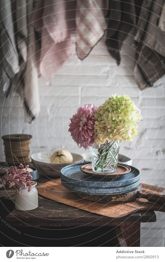 Table with flowers in vase on trays near towels hanging on thread Flower Vase Tray Towel Thread Hanging Chrysanthemum Hydrangea bunch Plant Pan dish cloth Pin