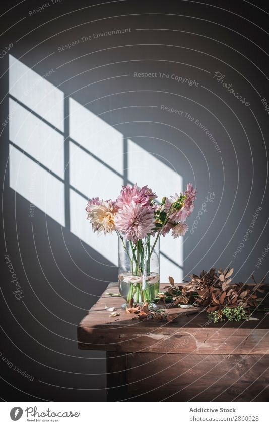 Bunch of flowers in vase near dry leaves on table Flower Table bunch Leaf Bouquet Chrysanthemum Vase Water Blossom leave Wall (building) Sun Dry Fallen Wood