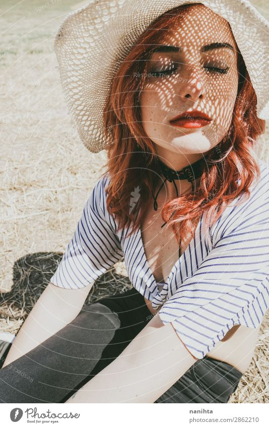 Redhead model protecting herself from sun Lifestyle Elegant Style Beautiful Skin Face Cosmetics Senses Relaxation Calm Vacation & Travel Summer Sun Sunbathing