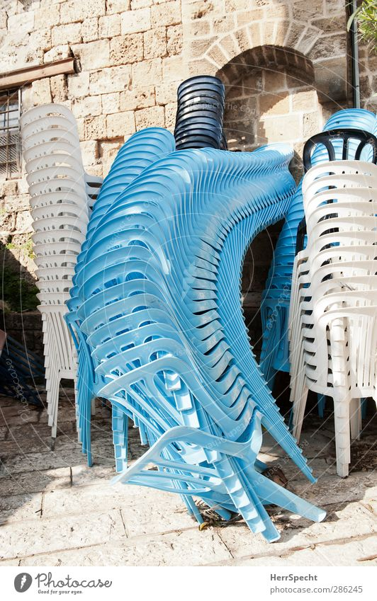 Always these impostors! Chair Jaffa Israel Old town Building Wall (barrier) Wall (building) Stone Plastic Funny Crazy Blue White Plastic chair Stack Mount up