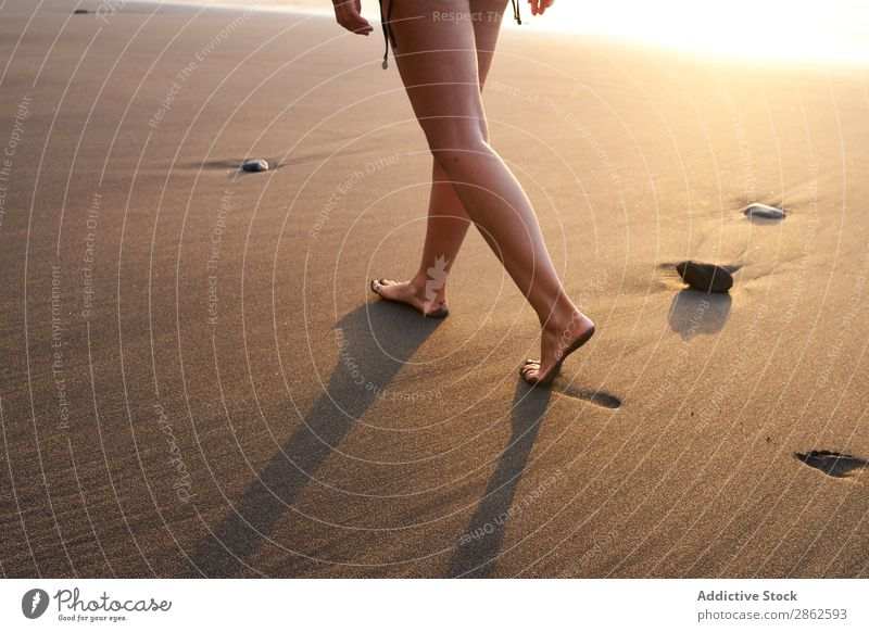 Crop woman strolling on sand of beach Woman Beach Footprint Walking Sand Steps Sunlight Remote Summer Ocean Smooth Coast Footstep Vacation & Travel Barefoot