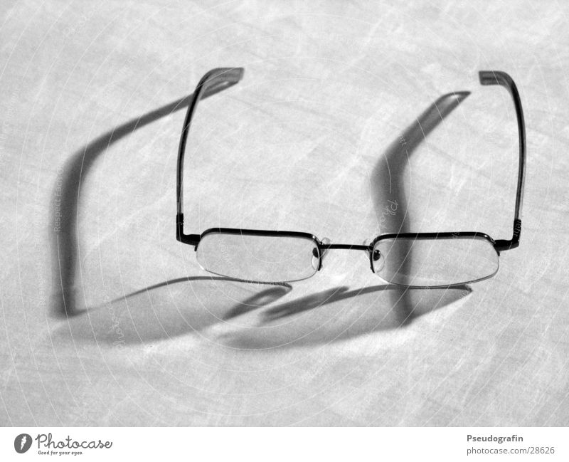 glasses Eyeglasses Glass Plastic Gray Spectacle frame Reflection Black & white photo Interior shot Close-up Neutral Background Evening Artificial light Shadow