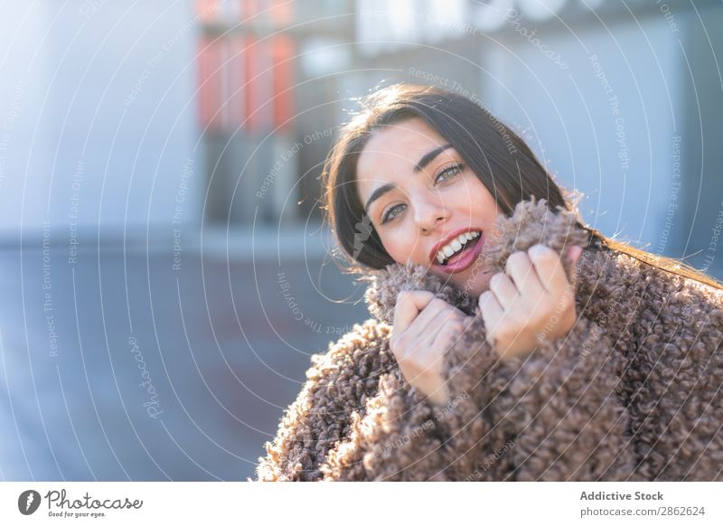 Cheerful woman wrapping in coat on street Woman Coat Street City Style Youth (Young adults) Sunbeam Day To enjoy Hip & trendy Fashion outfit Happy Smiling