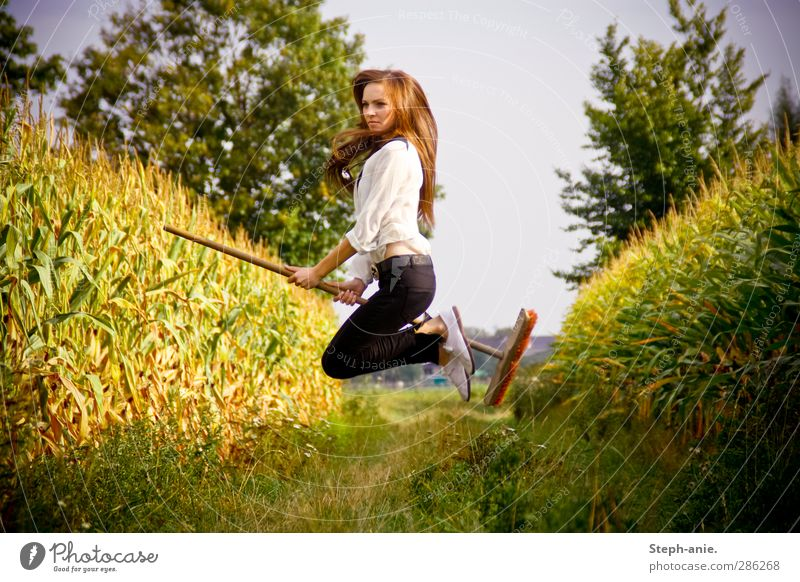 Wicked witch on mission! Feminine Young woman Youth (Young adults) 1 Human being Plant Cloudless sky Summer Autumn Tree Grass Maize Maize field Maize plants