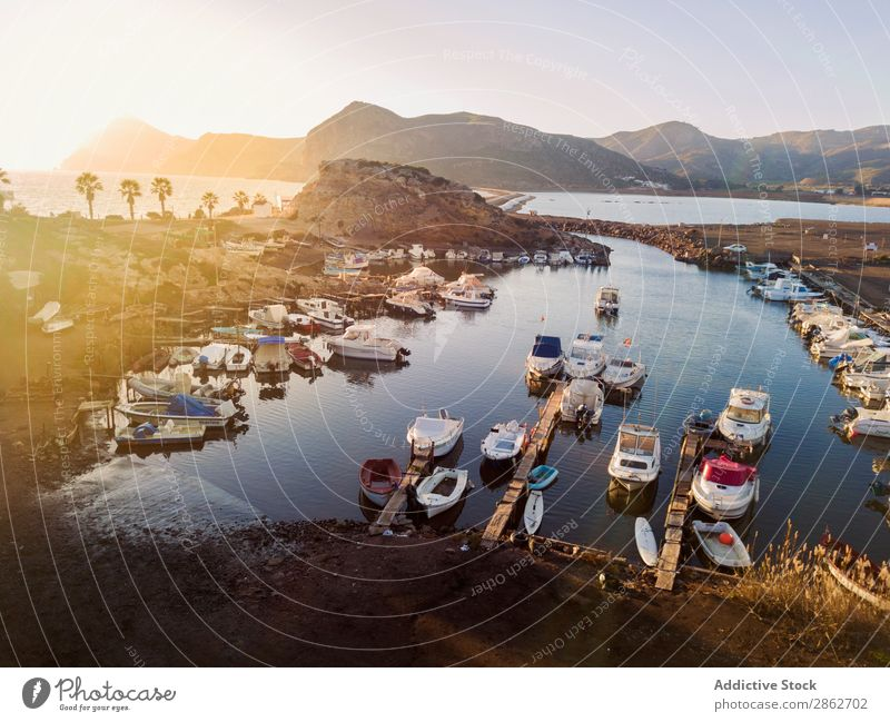 Motorboats in small dock Dock Jetty Watercraft Vacation & Travel Port Nautical Yacht harbour Aircraft drone view Sunlight Ocean Summer Harbour Bay