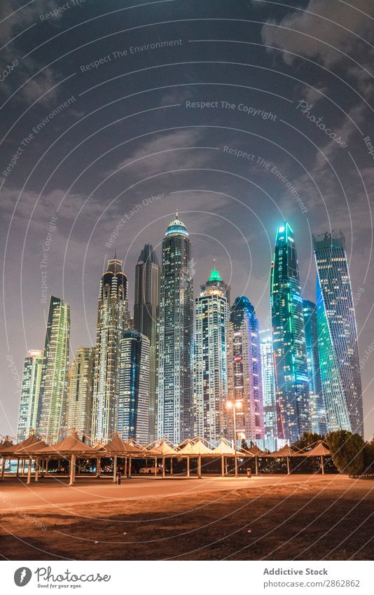 Cloudy sky over illuminated metropolis High-rise City Illuminate Evening Sky Clouds Dubai Architecture Town Skyline Downtown Modern Vacation & Travel Trip