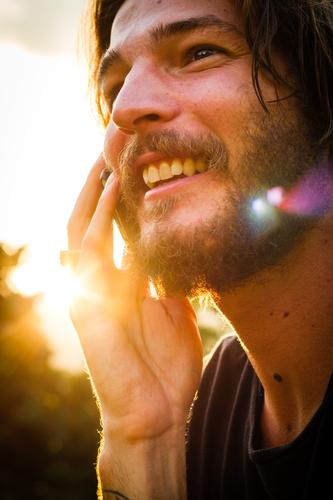 Sunny Call Man Human being Youth (Young adults) Young man Facial hair Alternative Rocker Beard Telephone To call someone (telephone) Cellphone Laughter Smiling