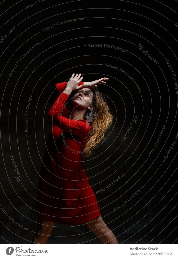 Young woman dancing in darkness Ballet Dance Ballerina red dress Dress Woman Hand Performance Room Red Elegant Dark Art pose Shows Smock obscurity grace
