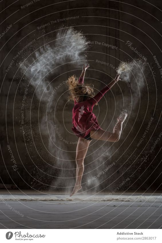 Young woman between fog in darkness Ballet Ballerina Fog Powder Dance Dress Woman Legs Hand upped Performance Room Red Elegant Dark Art pose Shows Smock