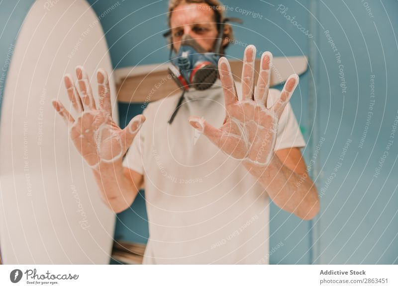 Man in respirator showing hands in dust Hand Dust Workshop Surfboard Indicate Wood Palm of the hand carpentry Workplace Breather Carpenter Tool Weapon