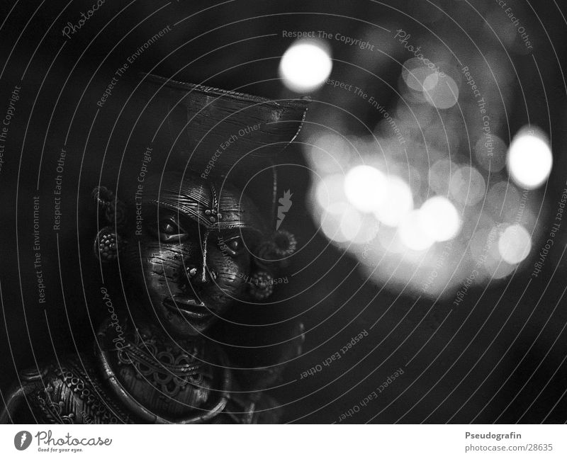 mask Mask Metal Esthetic Dark Chandelier Shop window Black & white photo Detail Deserted Artificial light Reflection Low-key Blur Looking