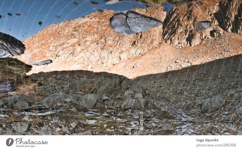 Stones on the horizon Environment Nature Landscape Rock Mountain Desert Gravel Stone wall Adventure Abstract Mirror image Water Lakeside Mountain lake Horizon