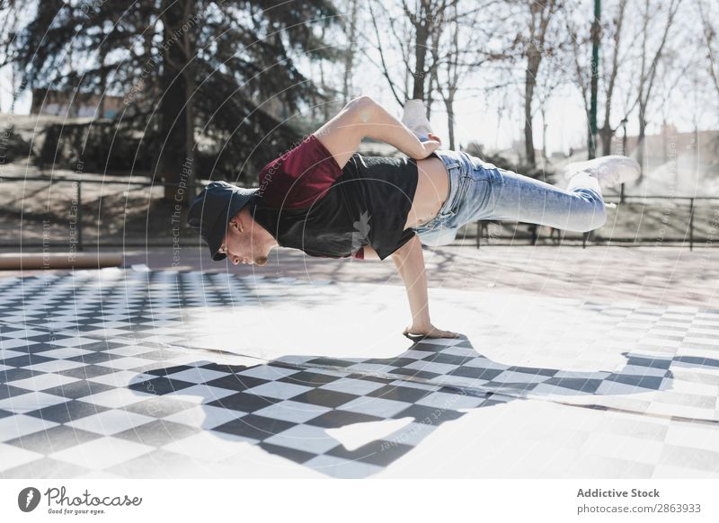 Man dancing break dance in park Breakdance Park Beautiful weather Dance Practice Style Athletic Jeans Youth (Young adults) Guy Sports Fitness flexibility