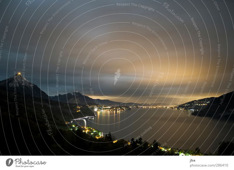 Lake Thun II Mountain Landscape Elements Air Water Sky Night sky Horizon Lakeside Traffic infrastructure Movement Dark Bernese Oberland Strip of light