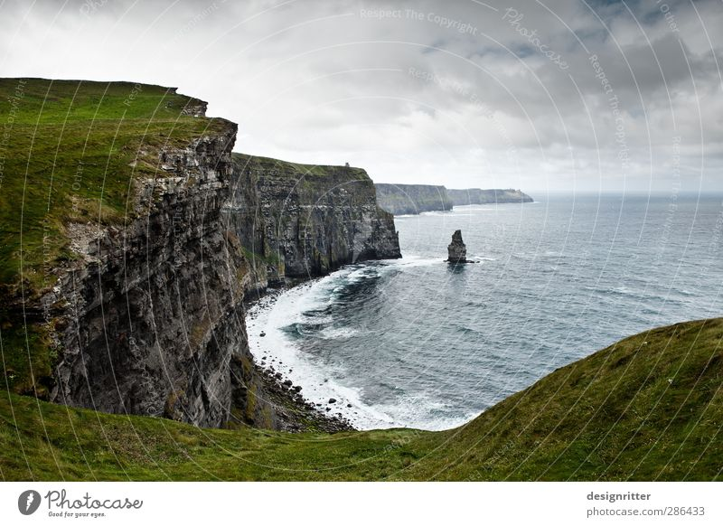 rough country Vacation & Travel Adventure Environment Water Clouds Gale Grass Hill Rock Mountain Cliff Coast Ocean Atlantic Ocean Cliffs of Moher Ireland Threat