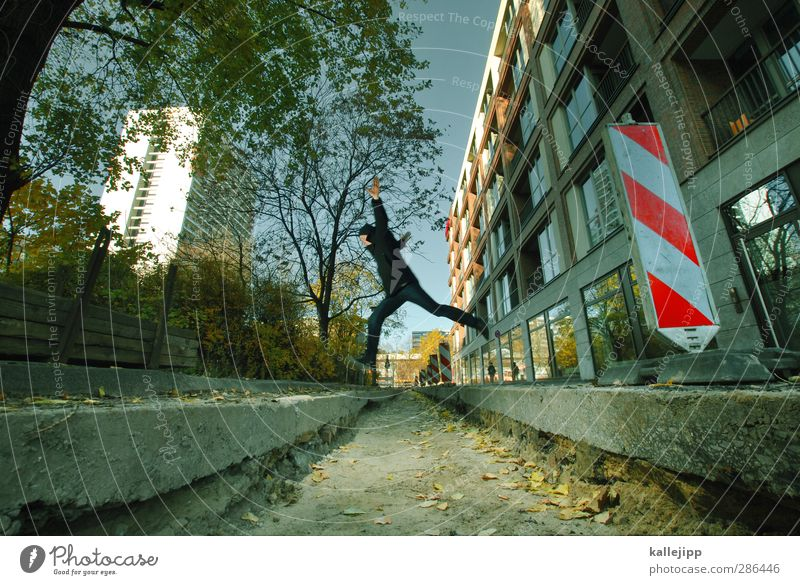 # Just a jump to the left # Human being Masculine Man Adults 1 30 - 45 years Jump Dig Barrier Construction site Signs and labeling High-rise Berlin Conquer