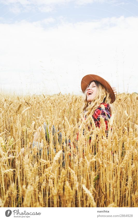 Young cowgirl in a field of cereals Woman Human being Nature Youth (Young adults) Young woman Summer Plant Beautiful Landscape Joy Healthy 18 - 30 years