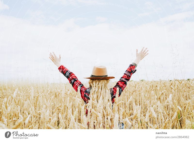 Young cowgirl in a field of cereals Woman Human being Sky Nature Youth (Young adults) Young woman Summer Plant Beautiful Landscape Joy Healthy Lifestyle Adults
