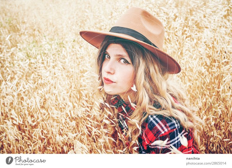 Young cowgirl in a field of cereals Lifestyle Style Beautiful Wellness Well-being Senses Freedom Summer Industry Human being Feminine Young woman