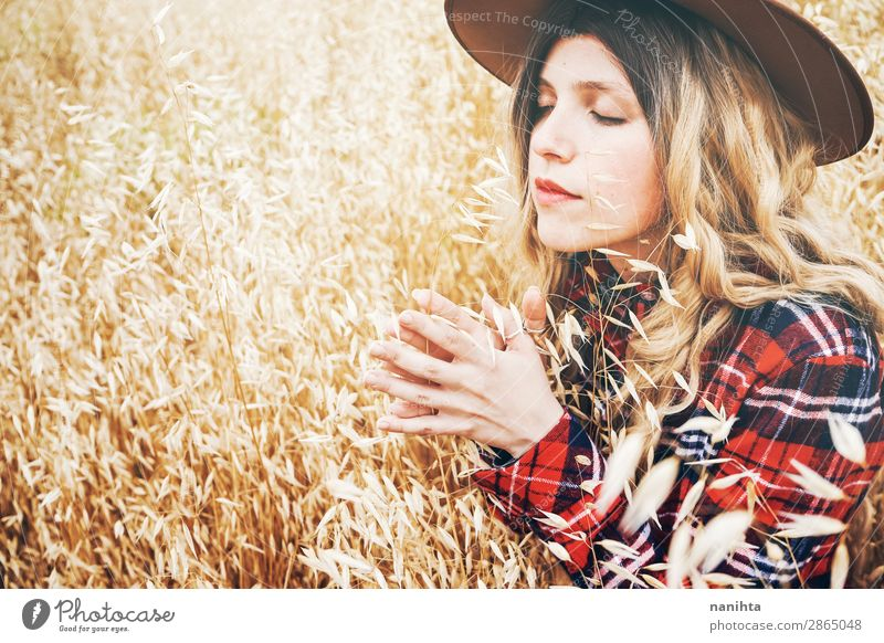 Young cowgirl in a field of cereals Lifestyle Beautiful Hair and hairstyles Wellness Well-being Senses Relaxation Calm Freedom Summer Industry Human being