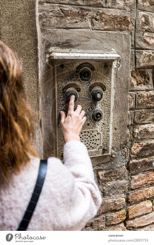 Woman pushing ancient intercom in Venice, taly Human being Vacation & Travel Youth (Young adults) Old Young woman Town Beautiful White Hand