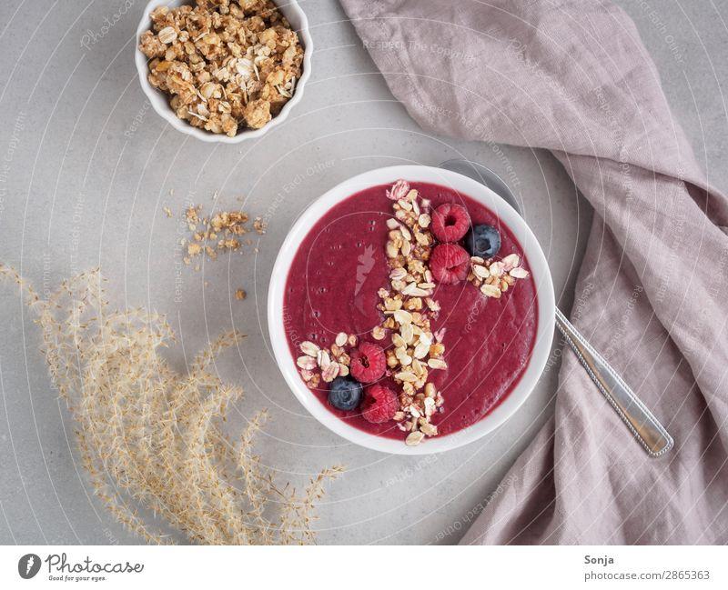 Smoothiebowl on red fruits Fruit Milkshake Raspberry Blueberry Nutrition Breakfast Vegetarian diet Diet Bowl Spoon Lifestyle Healthy Healthy Eating Pure Cereal