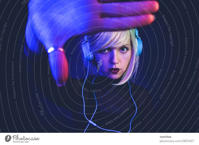 Young woman listening to music Lifestyle Beautiful Hair and hairstyles Face Night life Music Disc jockey Headset Technology Entertainment electronics