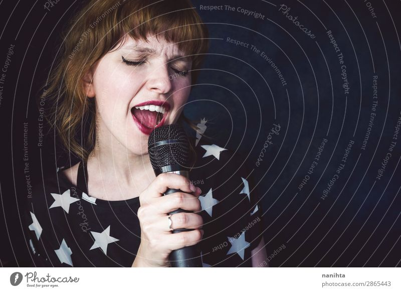 Young woman singing a song with a microphone Woman Human being Youth (Young adults) Beautiful White Dark Black 18 - 30 years Face Adults Feminine Art Fresh