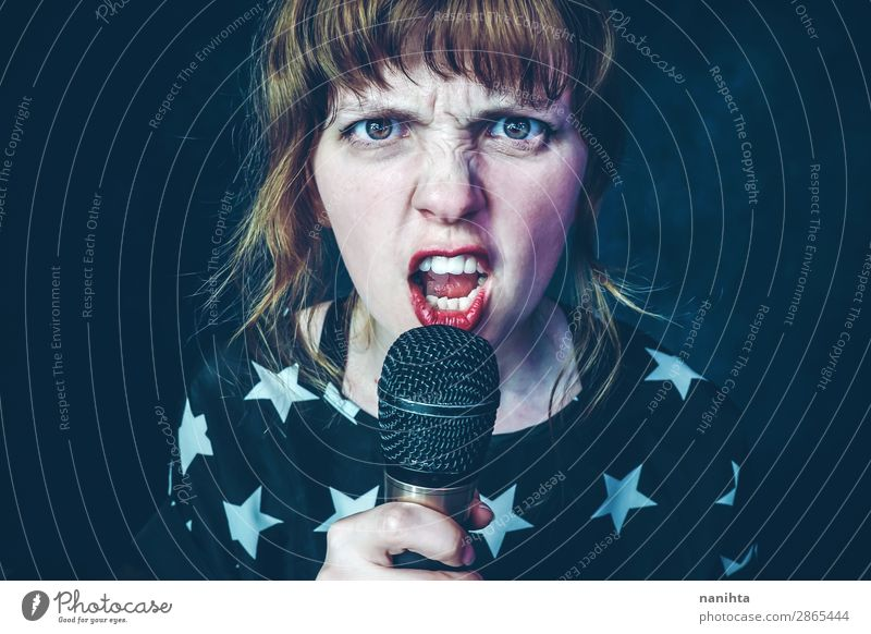 Young woman singing a song with a microphone Style Face Profession Media industry To talk Technology Human being Feminine Youth (Young adults) Woman Adults 1