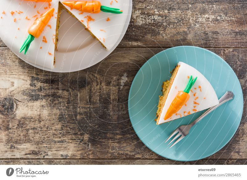 Sweet carrot cake slice on wooden table Healthy Eating Food photograph Orange Decoration Vegetable Candy Baked goods Cake Cream Dessert Snack Baking