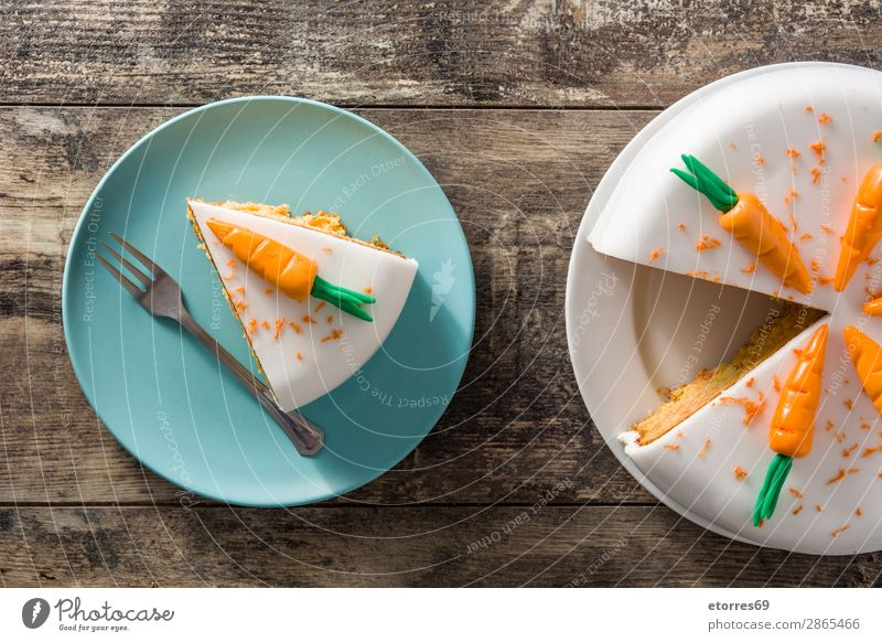 Sweet carrot cake slice on wooden table Healthy Eating Food photograph Orange Decoration Vegetable Candy Baked goods Cake Dessert Snack Baking Cheese Home-made