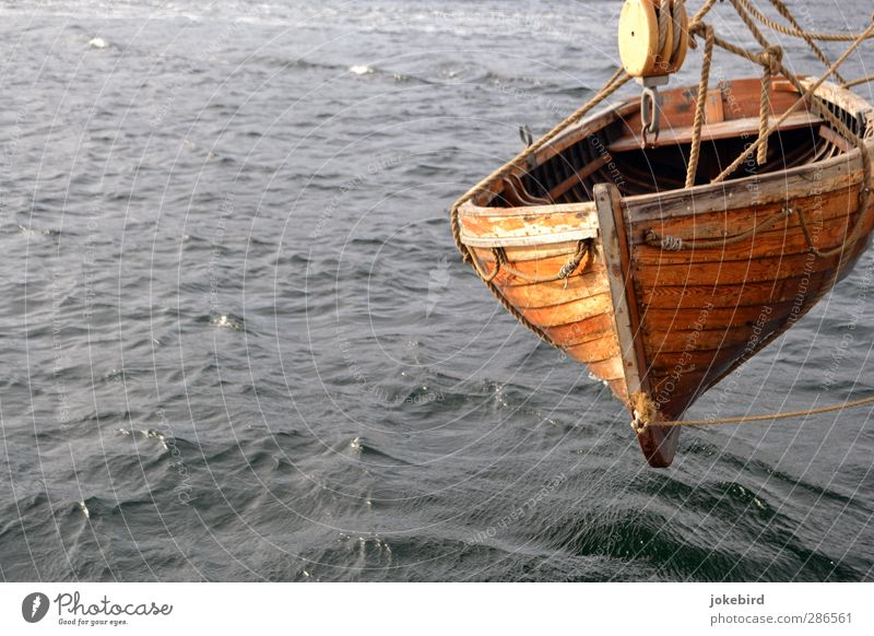 floating state Aquatics Rowboat Watercraft Waves Hang Gray Rope Pulley Colour photo Exterior shot Deserted Copy Space left Copy Space bottom Isolated Image