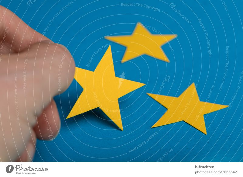 Blue Yellow Business Lie Success Fingers Stars Star (Symbol) Paper Sign Touch To hold on Select Advertising Industry Economy Career