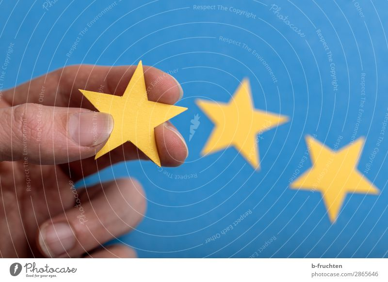 three stars Economy Advertising Industry Gastronomy Business Fingers Paper Sign Select Touch To hold on Success Blue Yellow Value Star (Symbol) Recommendation