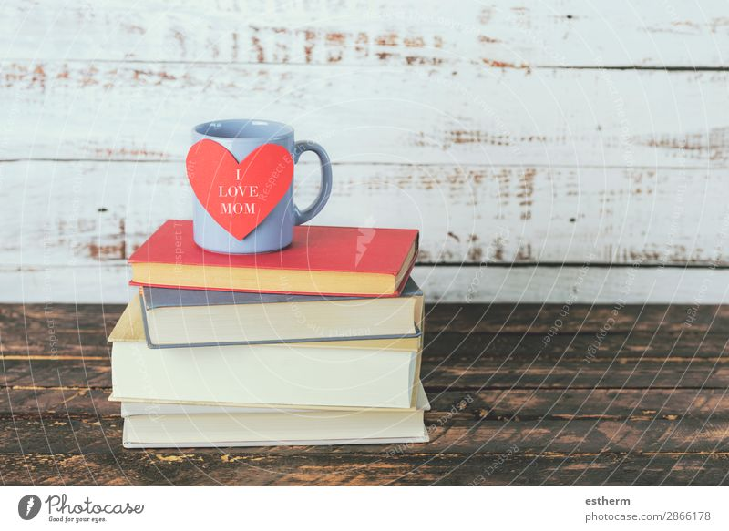 I love mom, books next to a cup of coffee Milk Coffee Tea Joy Leisure and hobbies Reading Decoration Table Feasts & Celebrations Mother's Day Adults