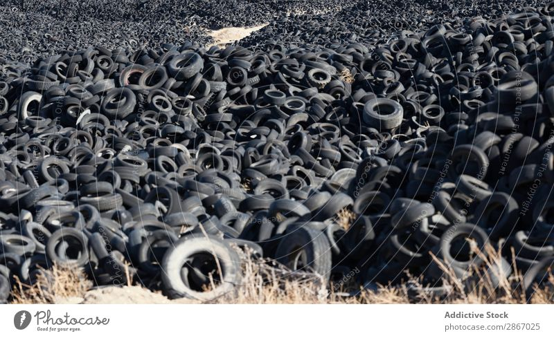 Heap of old tires between field Tire Field huge Car Accumulation Old Sky Beautiful weather Clouds Meadow Rubber Black Stack Second-hand Wheel dump Trash Nature