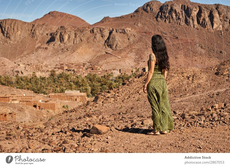 Woman between desert near mountains Desert Mountain Marrakesh Morocco Construction Landing Lady Youth (Young adults) Hill Brunette Ancient Old Building
