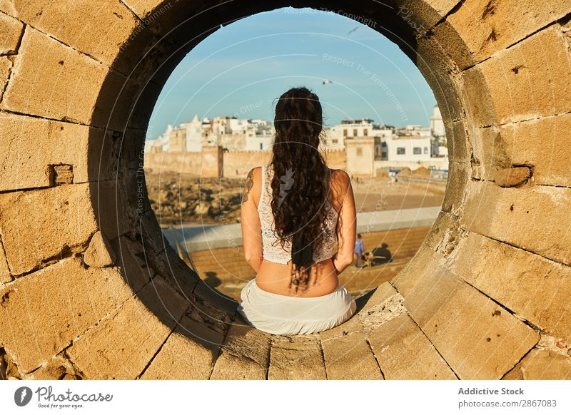 Woman sitting on stone monument near ancient town Stone City Monument Marrakesh Morocco Ancient Rock Town Old Youth (Young adults) Sit Brunette