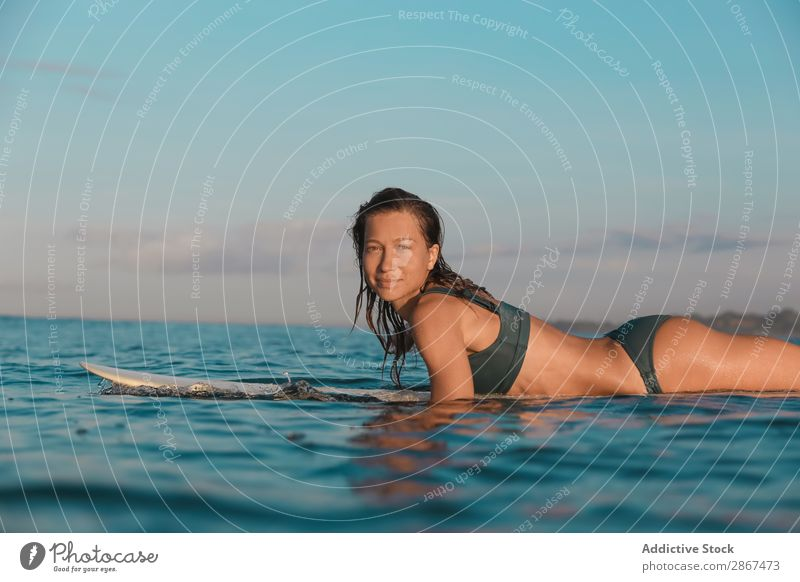 Smiling woman on surf board floating on water Woman Surfboard Water Sports Bali Indonesia Surfing Wave