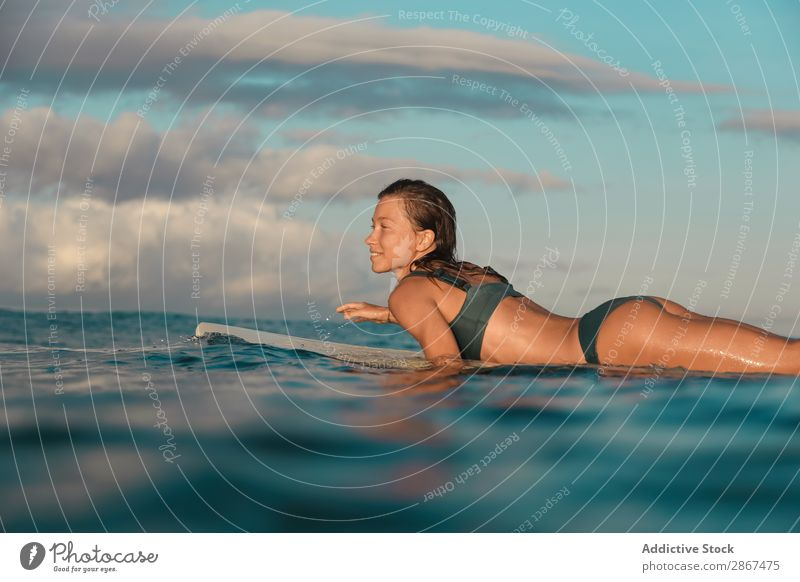 woman on surf board floating on water Woman Surfboard Water Sports Bali Indonesia Surfing Wave