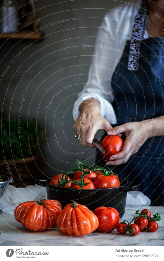 Woman cutting tomatoes in pot at table Tomato Pot Table Vegetable Red Mature Knives Fresh big Food Lady Meal Rustic Healthy Cooking Organic Delicious