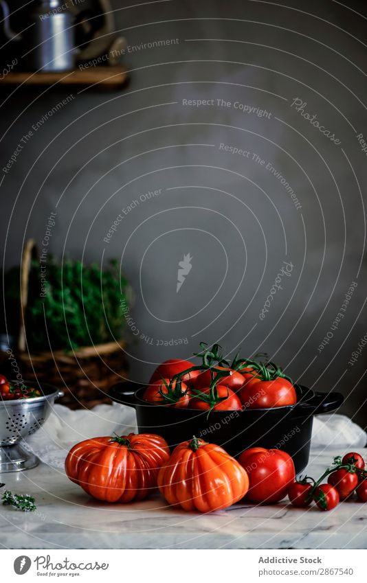 Ripe fresh tomatoes in pot on table Tomato Pot Table Red Mature Form (document) Fresh big Exceptional Wall (building) Gray Food Vegetable Meal Rustic Healthy