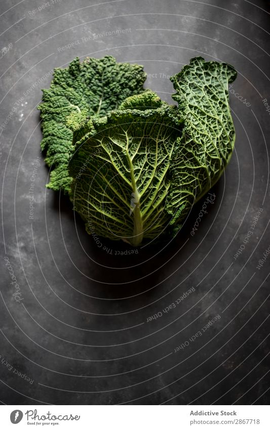 Woman holding fresh cabbage on table Cabbage Vegetable Food Chopping board Table Hand Green Fresh big Mature Rustic Vitamin Healthy Organic Nutrition Plant