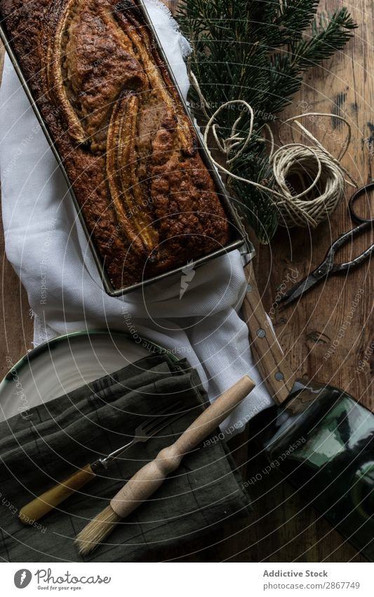 Healthy banana bread on cutting board Bread Banana Chopping board Bakery Container Knives Napkin Baked goods Twig coniferous Thread twist Branch Cake Sweet Food