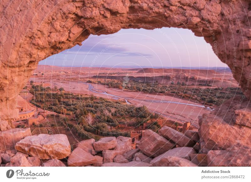 Stones with round hole and view on valley with river Valley River Desert Hole Marrakesh Morocco Mountain Round Circle Height Rock Amazing Vantage point